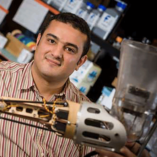 Man posing with prosthetic arm