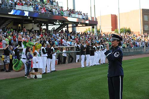 Soldier singing anthem at baseball game